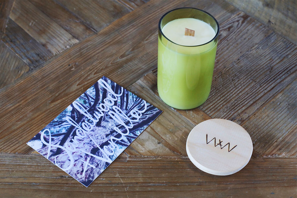 We Are Wild sandalwood + vanilla recycled wine bottle soy candle